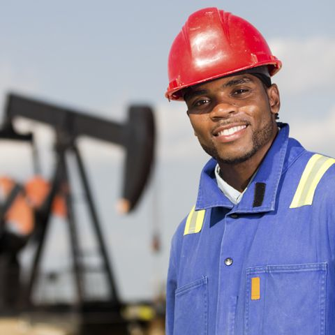 Picture of a man in a oil plant